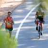 "Runner, Dan Gorman, left runs with Sandy Butterfield up Flagstaff.<br /> The ""John Henry Challenge"" was held on Friday, with a man vs machine race up Flagstaff Mountain.  The race is named in honor of John Henry the ""steel driving man"" who worked by hand and hard labor and nearly beat the steam hammer to lay railroad tracks.  Eight cyclists from Boulder Wind Power  challenged one of their colleague Dan Gorman, a nationally ranked runner who thought he can make it up to the summit of Flagstaff before any of the cyclists. <br /> For more photos and a video of the race, go to  <a href=""http://www.dailycamera.com"">http://www.dailycamera.com</a><br /> Cliff Grassmick / June 14, 2012"