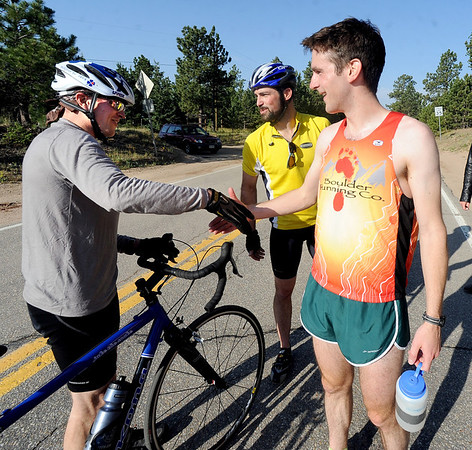 "Dan Gorman, right, congratulates Jason Lawrence, the overall winner of  the 5-mile race up Flagstaff Mountain.<br /> The ""John Henry Challenge"", was held on Friday, with a man vs machine race up Flagstaff Mountain.  The race is named in honor of John Henry the ""steel driving man"" who worked by hand and hard labor and nearly beat the steam hammer to lay railroad tracks.  Eight cyclists from Boulder Wind Power  challenged one of their colleague Dan Gorman, a nationally ranked runner who thought he can make it up to the summit of Flagstaff before any of the cyclists. <br /> For more photos and a video of the race, go to  <a href=""http://www.dailycamera.com"">http://www.dailycamera.com</a><br /> Cliff Grassmick / June 14, 2012"