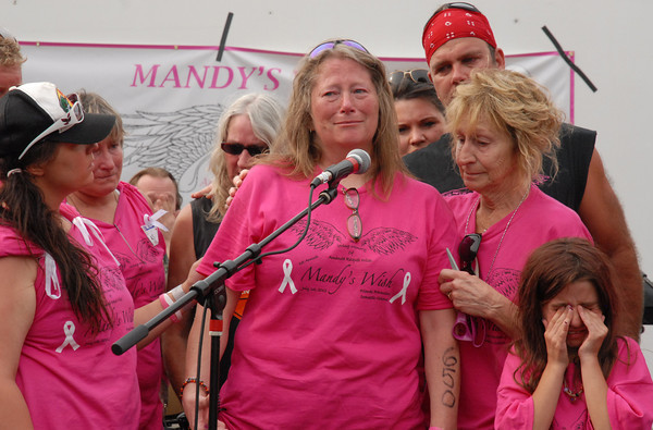 Terri Wiles fights back tears while being  comforted by her mother Betty Dietrich at the Mandy's Wish memorial held Sunday in downtown Lapel. Terri is the mother of Amanda Wiles who was fatally shot by Roy Parmley in early June who was Terri's ex-boyfriend. Parmley, the alledged killer, is still at large.