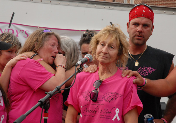Betty Dietrich addresses the crowd at Mandy's Wish while her daughter Terri Wiles gets comfort from a friend.