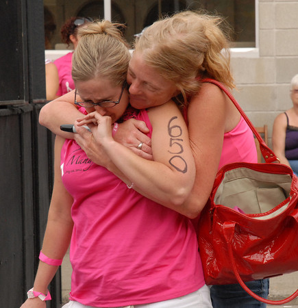 """Kris Betts hugs Popi Chadwell during the playing of """"Wish You Could Love Me Again""""."""