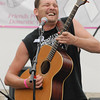 Norman Ray Leever plays an acoustic guitar solo during his performance with Kountry Khaos.
