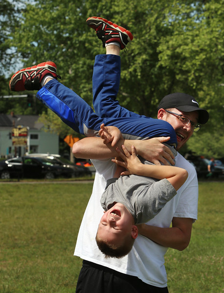 Shout Walk-a-thon against domestic violence, along Pawtucket Boulevard ending at Sampas Pavilion. Eric Tarmey of Lowell plays with his girlfriend's son, Connor Gauthier, 7, of Chelmsford.  SUN/Julia Malakie