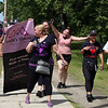 Shout Walk-a-thon against domestic violence, along Pawtucket Boulevard ending at Sampas Pavilion. From left, Jacqueline Carrion of Lowell, Rosa Burgos of North Andover, Tareena Pagan of Lowell (rear, holding banner), Burgos' daughter Yashira Hernandez of Danvers, Carla Rodriguez of Lowell, and Yarelis Castro, 14, of Danvers (Hernandez' daughter).  SUN/Julia Malakie