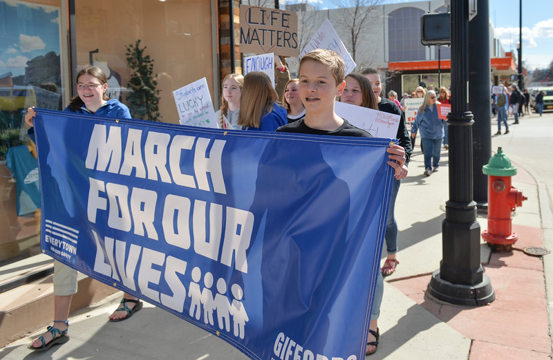Justin Sheely | The Sheridan Press<br /> Middle school students lead the march during The March for Our Lives demonstration on Main Street in Sheridan Saturday, March 24, 2018. Sheridan area students and community members participated in the march in solidarity with the rally in Washington, D.C.