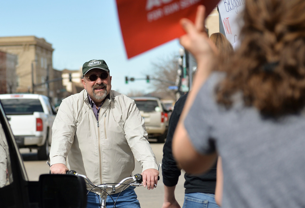 Justin Sheely | The Sheridan Press<br /> Sen. Bruce Burns, R-Sheridan, looks on as marchers walk by during The March for Our Lives demonstration on Main Street in Sheridan Saturday, March 24, 2018. Sheridan area students and community members participated in the march in solidarity with the rally in Washington, D.C.