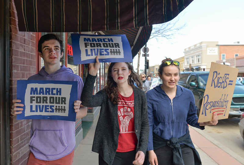 "Justin Sheely | The Sheridan Press<br /> From left, Jack McTiernan, Rachel Jahiel and Sky Stanton chant ""Don't be silent, end the gun violence"" during The March for Our Lives demonstration on Main Street in Sheridan Saturday, March 24, 2018. Sheridan area students and community members participated in the march in solidarity with the rally in Washington, D.C."