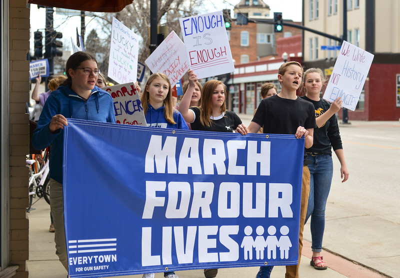 Justin Sheely | The Sheridan Press<br /> Marches chant during The March for Our Lives demonstration on Main Street in Sheridan Saturday, March 24, 2018. Sheridan area students and community members participated in the march in solidarity with the rally in Washington, D.C.
