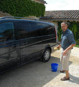 Claude spends another day washing cars before the wedding.