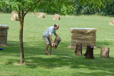 Alexandre sets up logs as chairs for the Marche Gourmand.