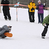Record-Eagle/Keith King<br /> Mary Sligay, right, shouts words of encouragement and takes photos of Melanie Dunbeck, both of Dearborn, as Dunbeck competes in the seal-slide event Saturday, March 5, 2011 during Mardi Gras & Slush Cup Weekend at Shanty Creek Ski Resort.