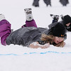 Record-Eagle/Keith King<br /> Rylee Stiles, 9, of Lansing, crawls toward the finish line as she competes in the seal-slide event Saturday, March 5, 2011 during Mardi Gras & Slush Cup Weekend at Shanty Creek Ski Resort.