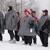 Record-Eagle/Keith King<br /> Participants wait for their turn in the seal-slide event Saturday, March 5, 2011 during Mardi Gras & Slush Cup Weekend at Shanty Creek Ski Resort.