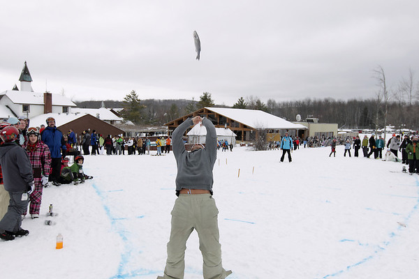Record-Eagle/Keith King<br /> Adam Remesz, of Auburn Hills, competes in the frozen fish toss Saturday, March 5, 2011 during Mardi Gras & Slush Cup Weekend at Shanty Creek Ski Resort.