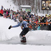 Record-Eagle/Keith King<br /> Craig Gossett, of Royal Oak, rides his snowboard across a pool of water Saturday, March 5, 2011 during Mardi Gras & Slush Cup Weekend at Shanty Creek Ski Resort.