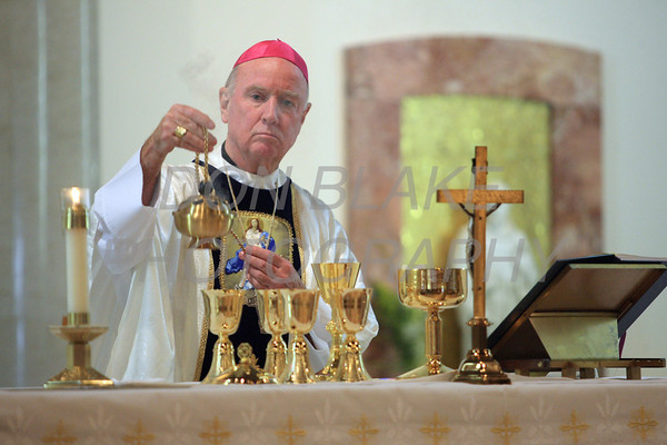 Bishop Malooly uses the incenser as he bless the alter during mass at the  Biennial Diocesan Marian Pilgrimage this year at the Shrine of Our Lady of Peace at Holy Spirit Church,  Saturday, October 22, 2011. photo/Don Blake Photography