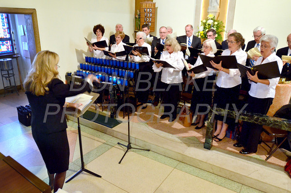 The choir from St. Joseph of the Brandywine sings during mass at the  Biennial Diocesan Marian Pilgrimage this year at the Shrine of Our Lady of Peace at Holy Spirit Church,  Saturday, October 22, 2011. photo/Don Blake Photography