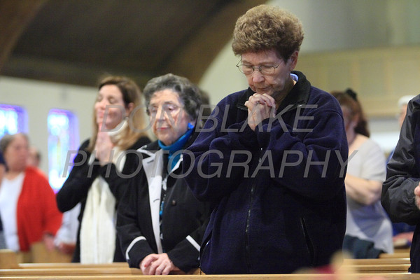 The faithful pray during mass at the  Biennial Diocesan Marian Pilgrimage this year at the Shrine of Our Lady of Peace at Holy Spirit Church,  Saturday, October 22, 2011. photo/Don Blake Photography