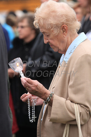 Romaine Rupp from Our Lady of Lourdes Parish prays the rosary at the foot of the Shrine of Our Lady of Peace during Biennial Diocesan Marian Pilgrimage this year at the Shrine of Our Lady of Peace at Holy Spirit Church,  Saturday, October 22, 2011. photo/Don Blake Photography