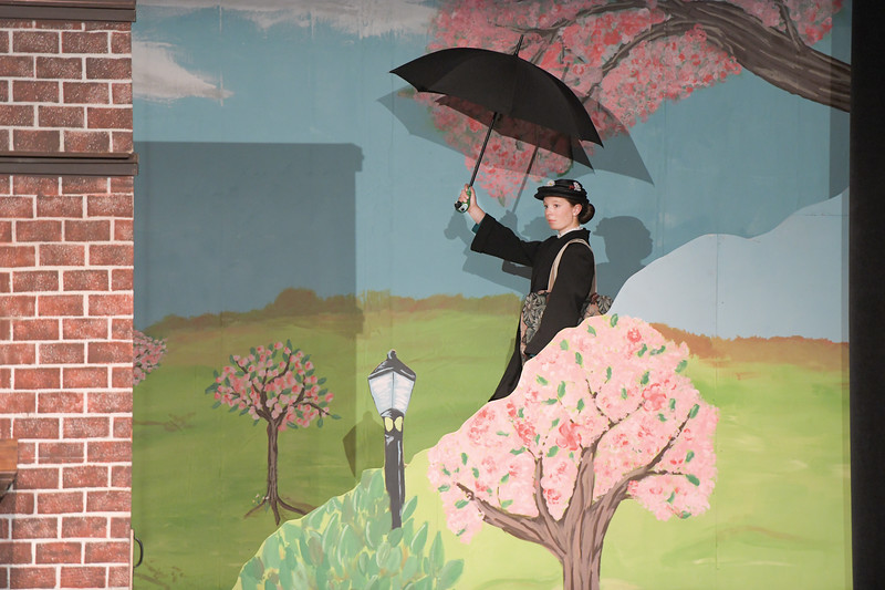 "Matthew Gaston | The Sheridan Press<br>Vivi Ostheimer as Mary Poppins floats into the Banks family's lives on the wind during Tandem Productions' presentation of ""Mary Poppins Jr."" at the WYO Performing Arts and Education Center Wednesday, June 12, 2019."