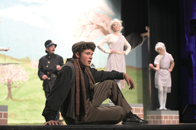 "Matthew Gaston | The Sheridan Press<br>Bert, played by Zach Allen, ponders his ""Practically Perfect"" chalk drawing during Tandem Productions' ""Mary Poppins Jr."" at the WYO Performing Arts and Education Center Wednesday, June 12, 2019."