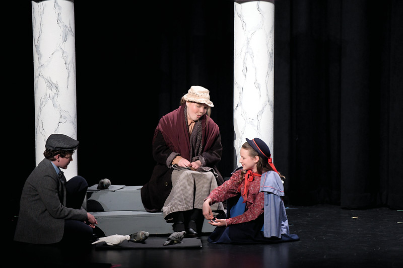 "Matthew Gaston | The Sheridan Press<br>The Banks children Michael and Jane, played by Camden and Charlize Gonda respectively, learn a lesson about judging a book by its cover after meeting the Bird Woman, played by Tate Bateman during Tandem Productions' ""Mary Poppins Jr."" at the WYO Performing Arts and Education Center Wednesday, June 12, 2019. Tandem Productions will be hosting an alumni showcase in celebration of their 25th anniversary Sunday, June 16th at 1:30 p.m. at the WYO Theater which will be free to the public."