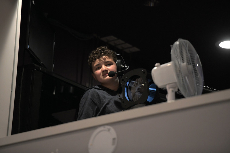 "Matthew Gaston | The Sheridan Press<br>Eleven-year-old Mike Odom worked behind the scenes for Tandem Productions presentation of ""Mary Poppins Jr."" to illuminate the magic at the WYO Performing Arts and Education Center Wednesday, June 12, 2019."