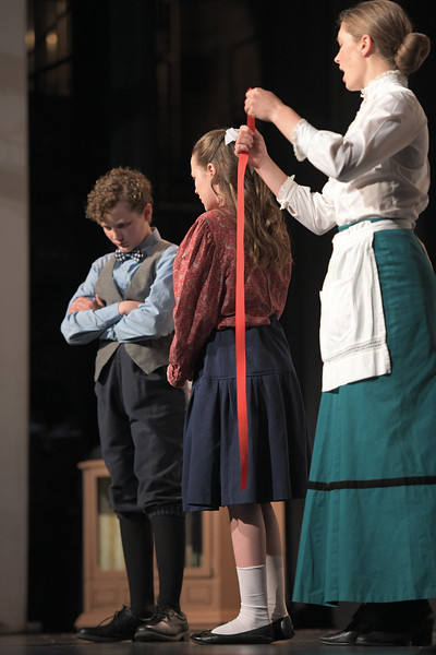 "Matthew Gaston | The Sheridan Press<br>Camden Gonda as Michael Banks pouts after being measured by Mary Poppins during Tandem Productions' ""Mary Poppins Jr."" Wednesday, June 12, 2019. Tandem Productions will be hosting an alumni showcase in celebration of their 25th anniversary Sunday, June 16th at 1:30 p.m. at the WYO Theater which will be free to the public."