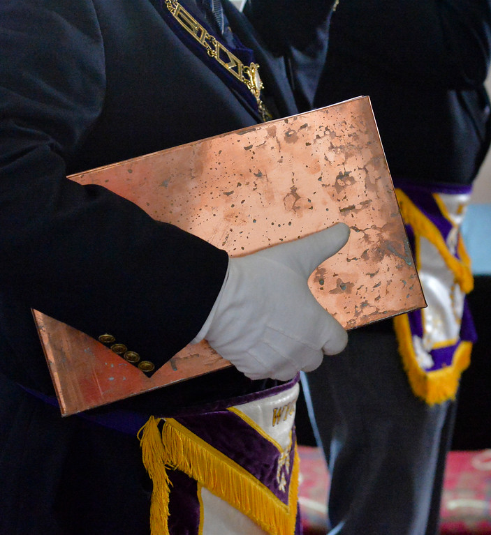Justin Sheely | The Sheridan Press	<br /> A mason carries the time capsule during the cornerstone dedication Saturday at the WYO Theater. The Grand Lodge of the Ancient Free and Accepted Masons of Wyoming held the ceremony to dedicate the WYO Performing Arts and Education Center addition, which was formerly the site of the Sheridan Lodge No. 8 through the 1960s.