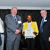 Tiara Bloodworth, Most Improved Scholarship, with Thomas McKenzie, James J. McKenzie, Esq., Chairman, MassBay Foundation, and President John O'Donnell