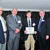 Patrick Rahill, John F. McKenzie Scholarship Recipient, with Thomas McKenzie, James J. McKenzie, Esq., Chairman, MassBay Foundation, and President John O'Donnell