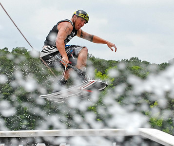Rusty Malinoski of Humboldt, Saskatchewan flies above a ramp while competing in the MasterCraft Pro Wakeboard Tour in Acworth Saturday afternoon.