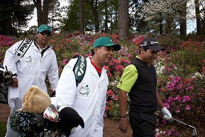 Andres Romero and caddies.