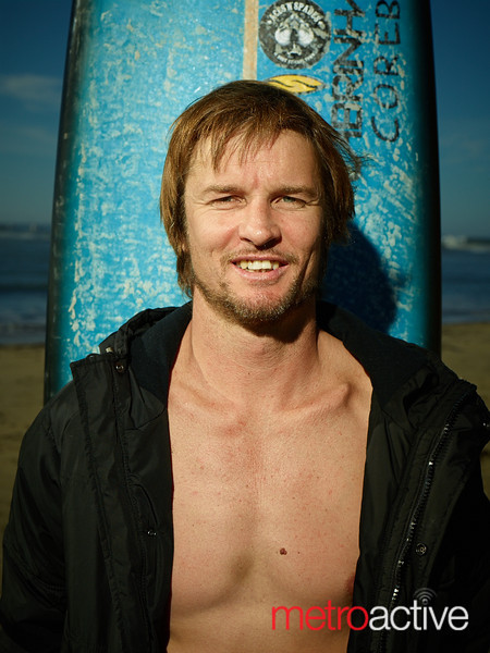 """Grant """"Twiggy"""" Baker before his heat at the 2013 Mavericks Invitational surf competition in Half Moon Bay, California.  Photo by Peter Adams  <a href=""""http://www.peteradamsphoto.com"""">http://www.peteradamsphoto.com</a>)."""
