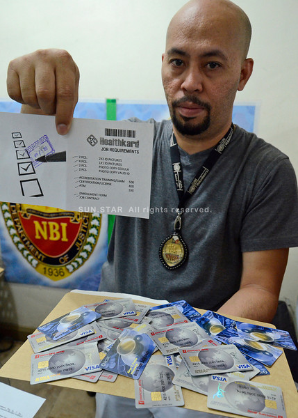 Illegal recruitment cards confiscated from a pastor in Davao City