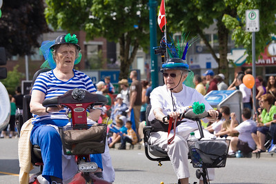Amica residents on scooters. May Day celebrations in Port Coquitlam 2013