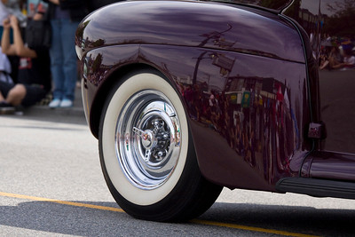 Hometown crowd reflected in vintage car fender. May Day celebrations in Port Coquitlam 2013