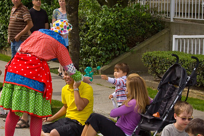 Lucas Lok receives balloon animal from Happy the Clown (permission given). May Day celebrations in Port Coquitlam 2013