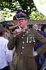 Man in World War I uniform blowing his horn at The Mayor's Thames Festival 2010