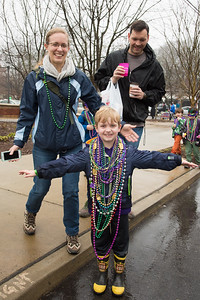 Jackson Poe and his parents are proud to take the honor of what must have been the most decorated spectator in the Mardi Gras parade