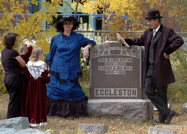 """Susan Schigur, and her daughters, Ella and Cali, left, listen to the story of George and Sarah Eggleston, played by Sharman and David Straub.<br /> For more photos and a video of the spirits, go to  <a href=""""http://www.dailycamera.com"""">http://www.dailycamera.com</a>.<br /> Cliff Grassmick / October 17, 2010"""