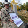"Donlyn Arbuthnot plays Mary Bader, ""the gold-digging wife"" at the site of her burial at Columbia Cemetery in Boulder.<br /> For more photos and a video of the spirits, go to  <a href=""http://www.dailycamera.com"">http://www.dailycamera.com</a>.<br /> Cliff Grassmick / October 17, 2010"