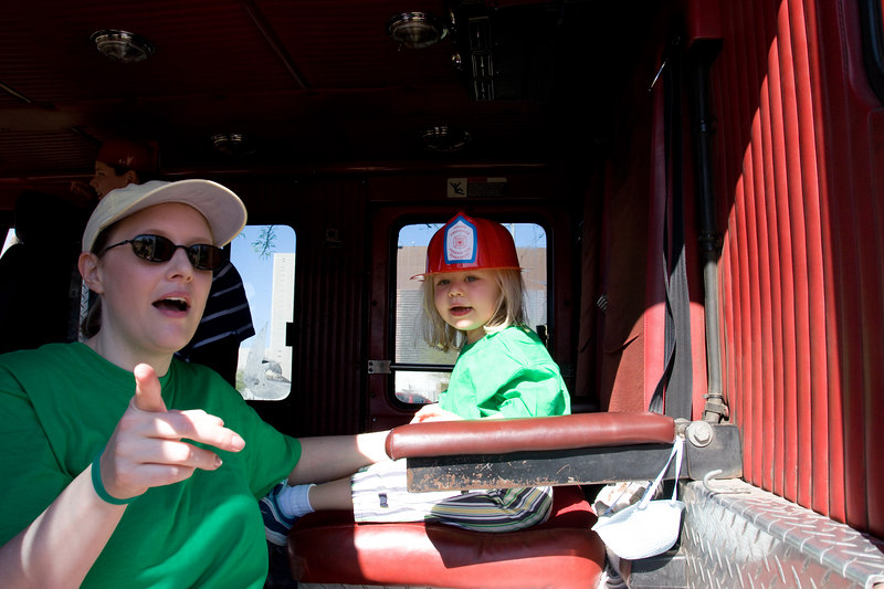 Megan and Mommy in the fire engine.