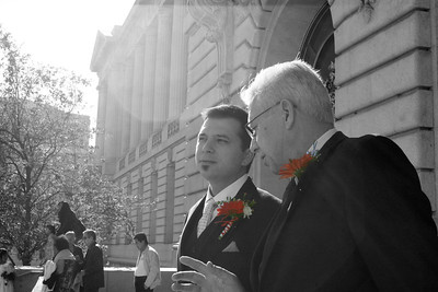 The groom receiving some sound advice from a wise man
