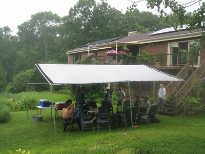 The party continued under the tarp (rather than move indoors, or risk being out on the lower lawn without shelter).