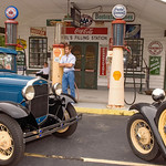 "Mel's Filling Station, Charleston, SC : Mel's Filling Station is a treasure trove of automobile memorabilia and miscellaneous collectibles.  Old fashioned cash registers, complete country post office with original mail boxes salvaged from a rural facility that had no further use for it.  Beautifully restored classic cars, a working jukebox that plays songs like Check Berry's ""My Dingaling"".  Mel Rauton, owner and a local legend, kindly gave us access to photograph his collection recently.  He, David Kennedy, Matt Kauffmann and Chambers Austelle participated in the shoot and we had a lot of fun.  Thank you Mel."