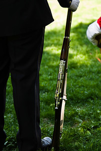 Police Rifle - A police officer holds his rifle steady during the final ceremonies.