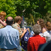 Folding the Flag -<br /> After lowering the flag in the town center, local Boy Scouts fold the flag for a veteran's family.