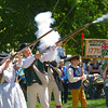 Twenty-one Musket Salute -<br /> Men and women reenact a revolution-era twenty-one gun salute.