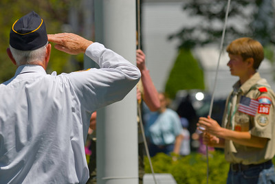 Lowering the Flag - A veteran salutes the flag as it's lowered to half-staff.